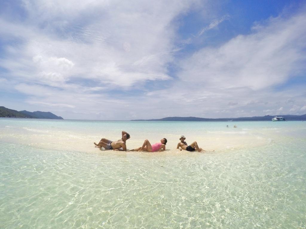 My friends Val, Hanni and Fikri on a sandbar on Pasir Timbul