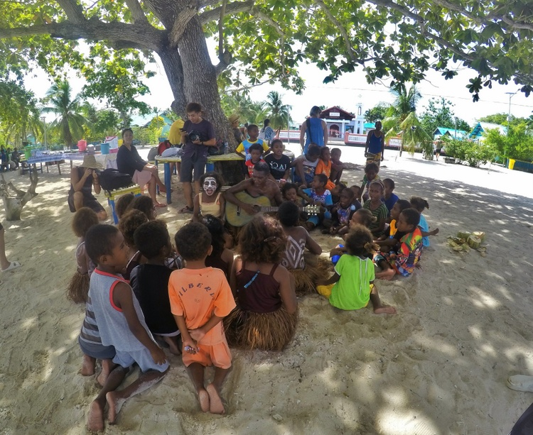 Singing with the locals on the beach at Arborek Village - Raja Ampat Travel Guide
